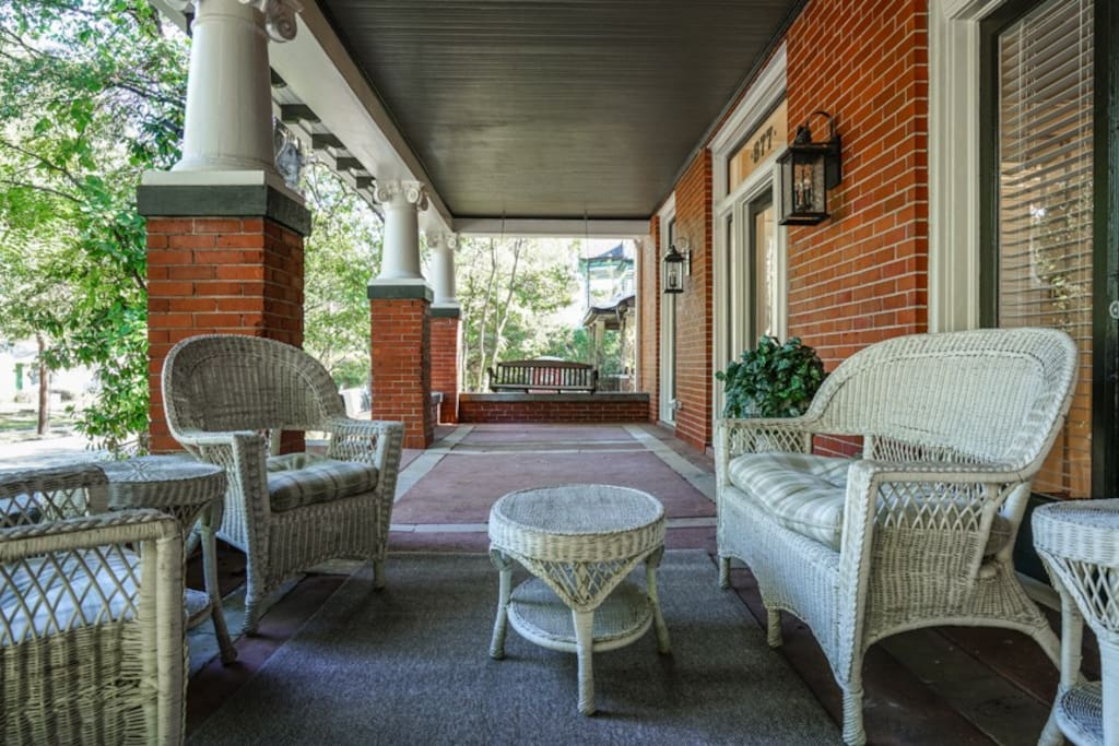 Enjoy the scenery from the deep traditional southern front porch