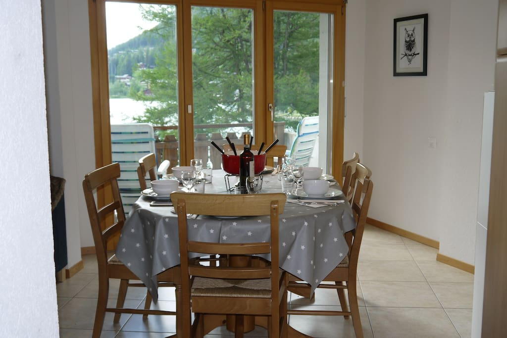 Dining area with separate balcony overlooking lake