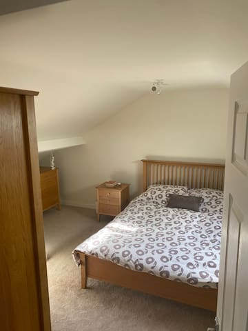 Bed  3 with (attic) wardrobe and large chest of drawers