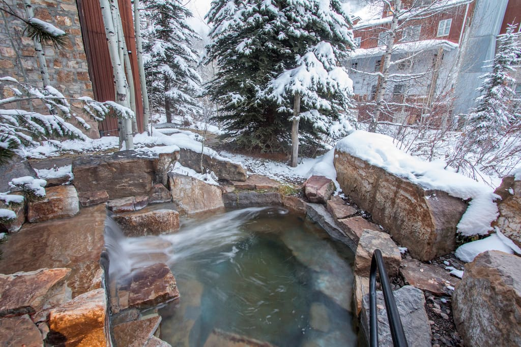 Soak your tired muscles after a long day of skiing in this stone hot tub right on the River Trail.