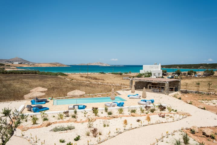 Funky holiday home with pool, next to the beach
