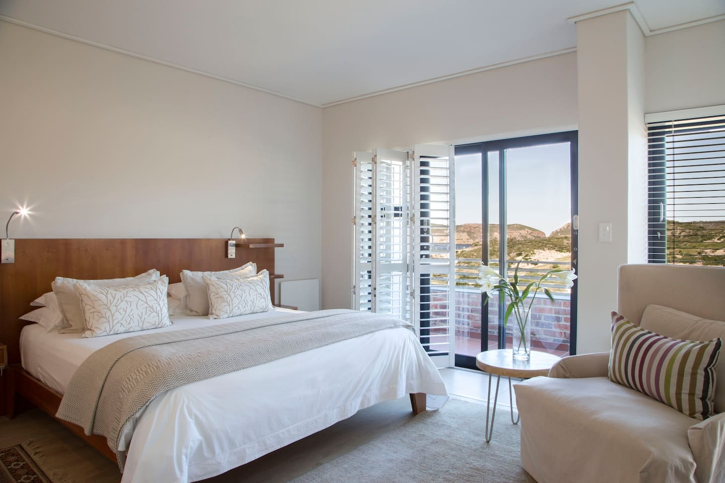 Room 5 is popular amongst Christiana Lodge's guests. It has views of the ocean from its balcony, a huge deck with loungers and an outdoor shower.