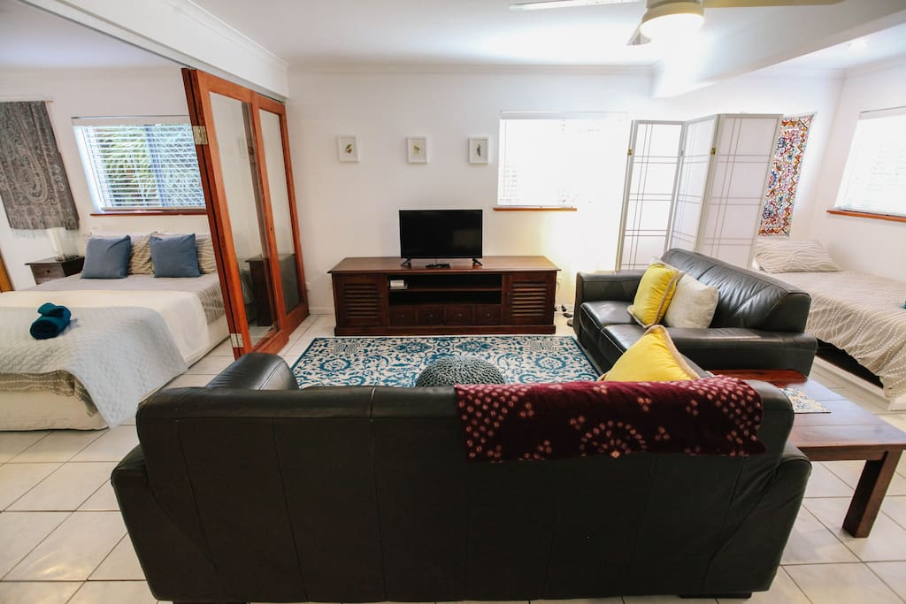 Comfy lounge area with TV, DVD player, ChromeCast Dongle, air con & ceiling fan