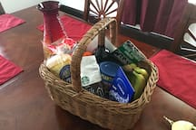 Birthday gift basket for 5 person group. Wine, Mandarins, Lindor Chocolate, Starbucks coffee, bananas, bagels, mixed nuts.