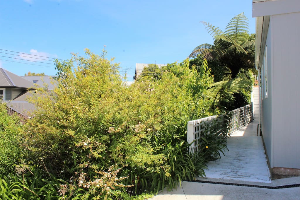Follow our bush-lined boardwalk to the left of the garage to our downstairs bedsit on your right.