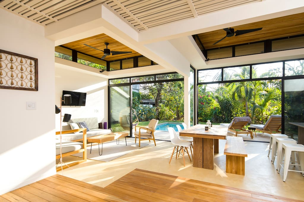 Spacious living/dining room and glass doors that fully open to the pool deck