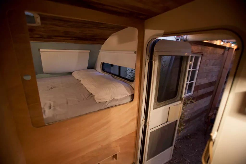 This is the sleeping pod for 2 inside the RV. There are 3 sleeping pods total with a slide door for privacy and your own storage space underneath. Each pod is equipped with lights, power outlet and wifi.