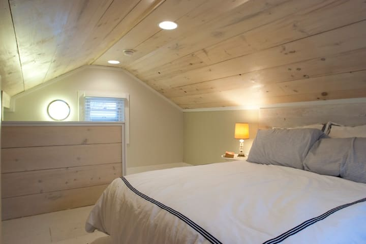 Upper level loft bedroom with full size bed.