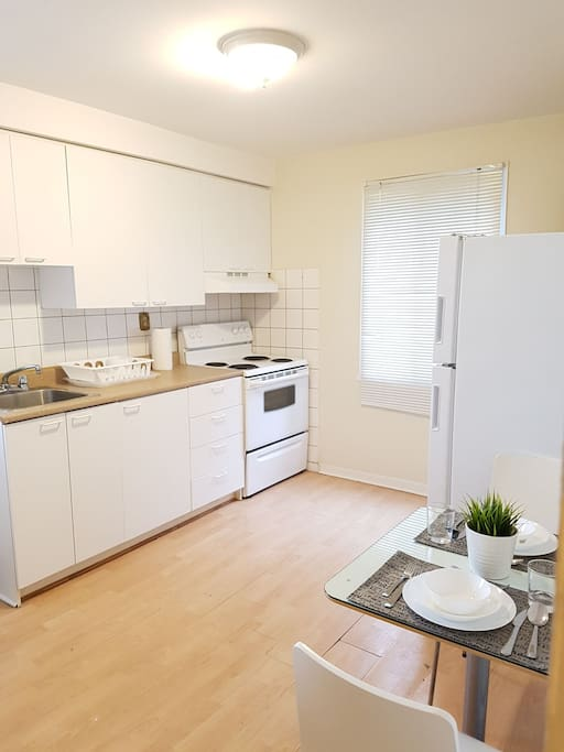 THE KITCHEN IS FULLY EQUIPED WITH PLATES, GLASSES, CUTLERY, DINNING TABLE, MICROWAVE, ETC.
