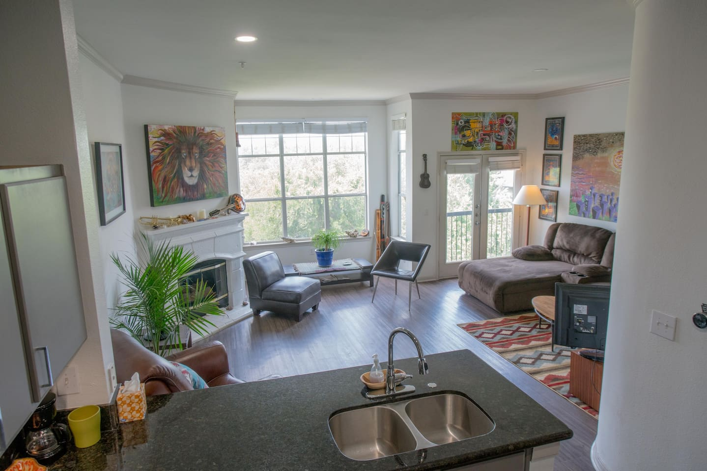Open floor plan loft style with views of the trees and Downtown Austin!
