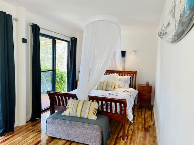 Queen bed with Sheridan Linen & mosquito net