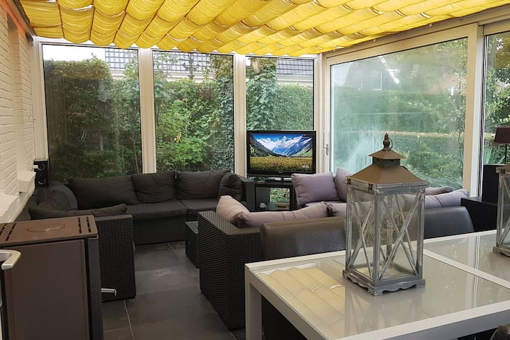 Sunroom for guests only with fireplace,  Chromecast TV and connected music system. Smoking allowed. Sliding doors to the park-like garden.