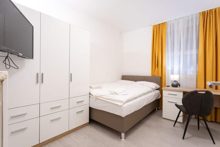 Double bedroom with a shared bathroom