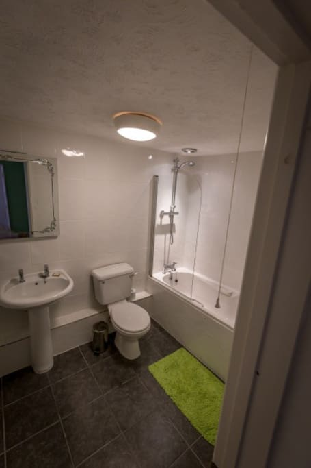 Ensuite bathroom with bath and shower