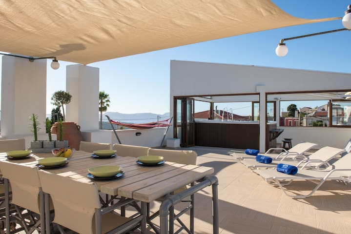 The roof terrace features sun beds and dining area.
