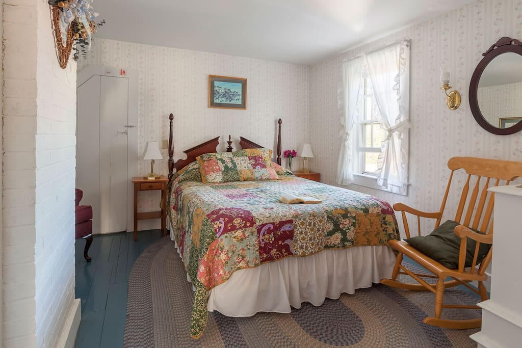 Room 7 in our 1860's Sea Captain's House offering a queen sized bedroom and private bathroom with large corner shower.