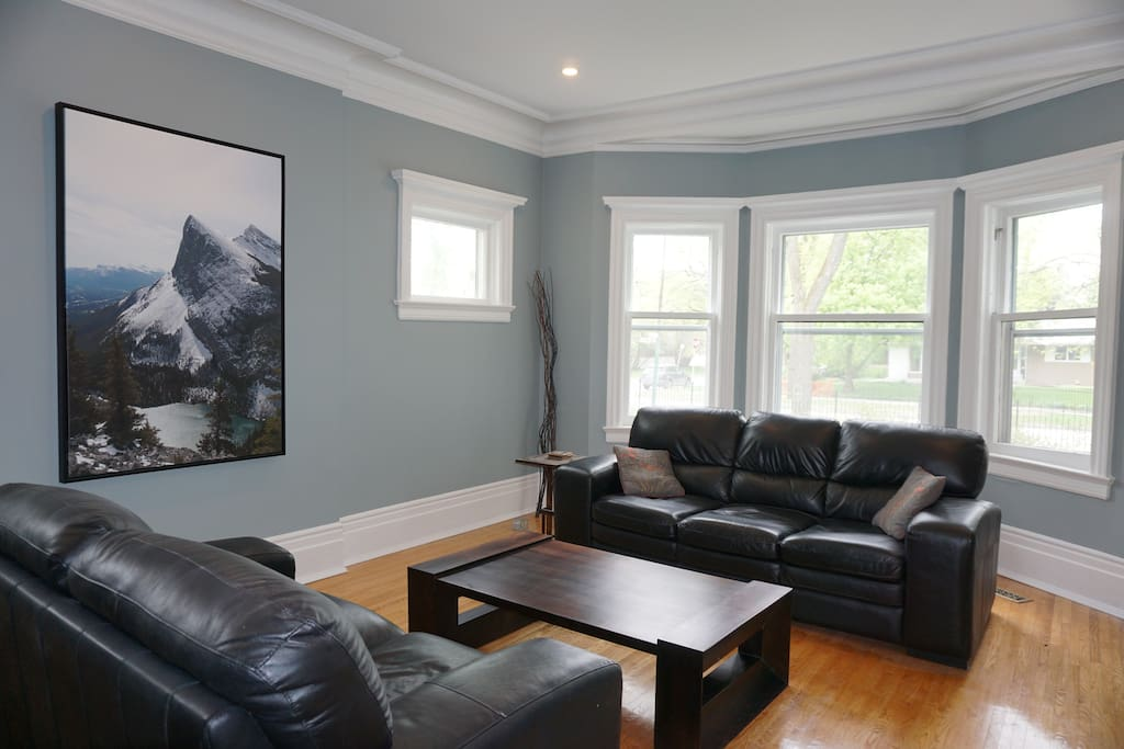 Spacious living room with large bay windows!