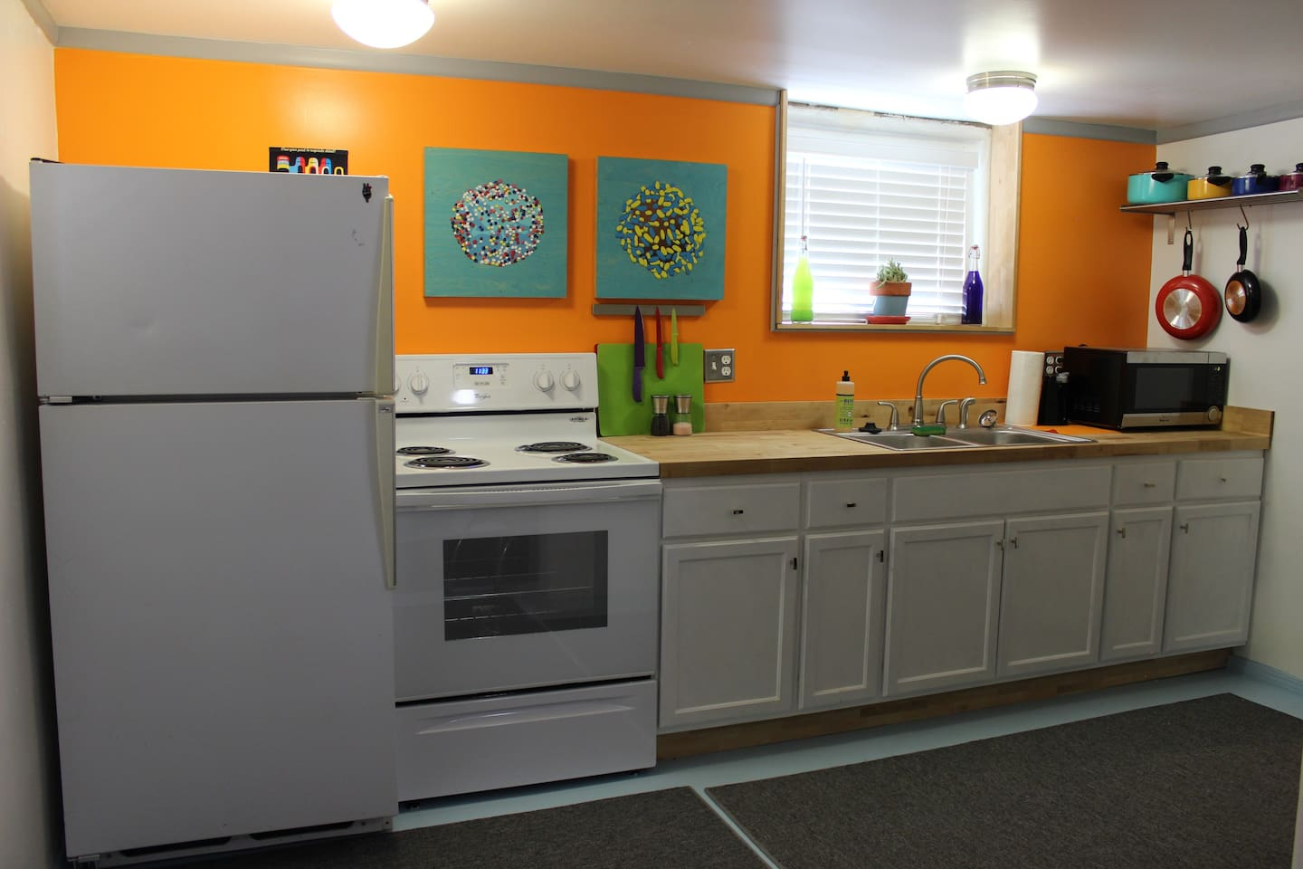 Fully functioning kitchen with fridge, stove, sink, microwave, can opener, k-cup coffee maker. Dishes, pots and pans, and silverware as well.