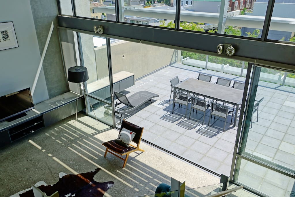 Contemporary open plan living area flows to expansive west facing deck
