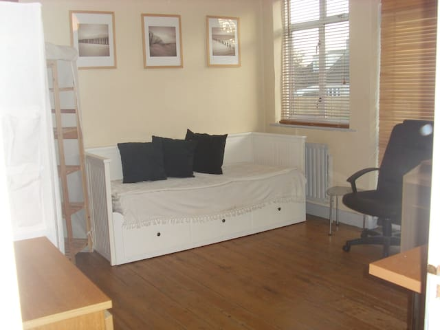 Large comfy room with original wood floors