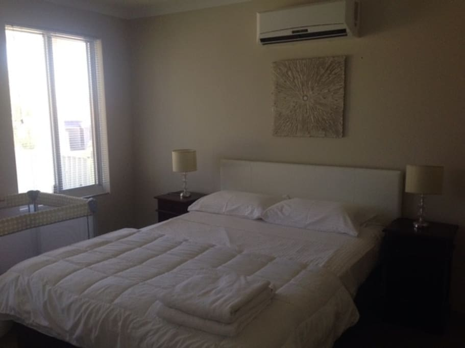 Bed 1 with an adjoining ensuite and reverse cycle air conditioning.