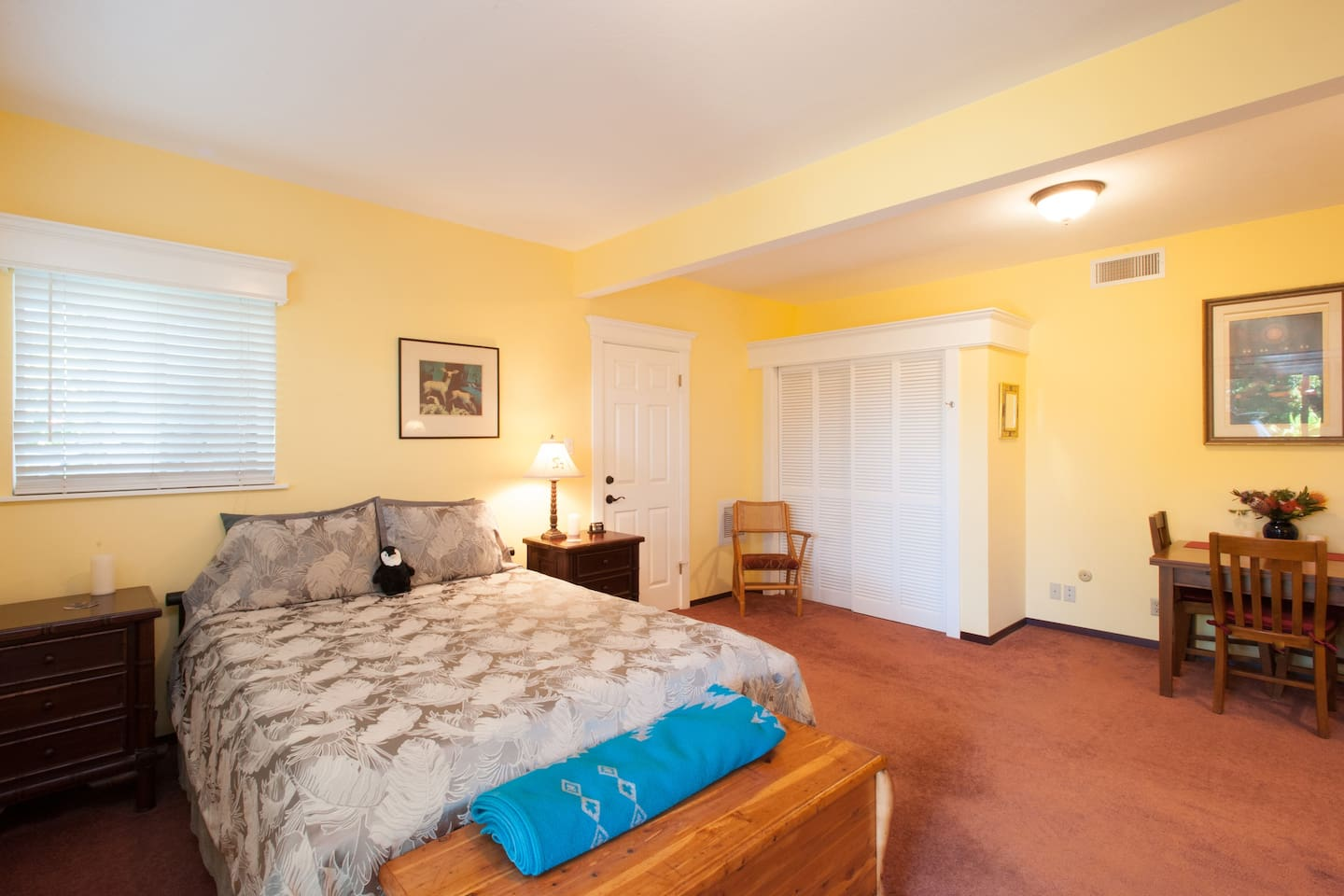 """Master bedroom with very comfortable queen size bed, table and chairs, full closet, WiFi, 42"""" HDTV with premuim cable like HBO and Showtime"""