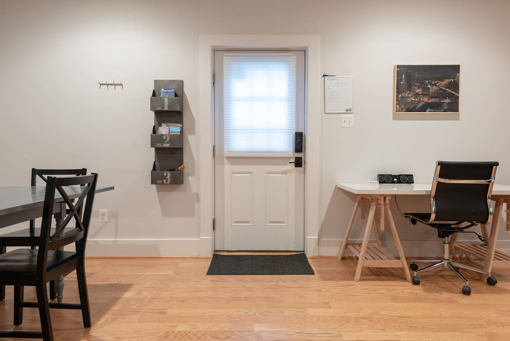 Entrance with smart lock and keypad entry.  Desk with charging station.