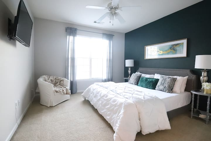 Master Bedroom with 40 inch smart tv