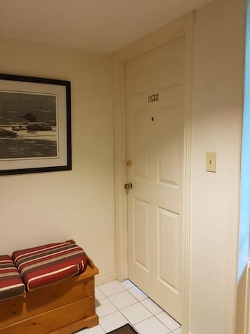 Private locked entrance from shared foyer