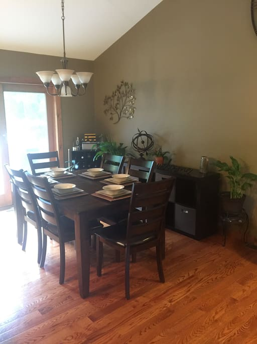 Open dining room with table that expands to fit 8 guests.