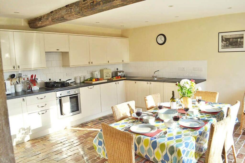 Ground floor: Large, well equipped kitchen with a spacious dining area