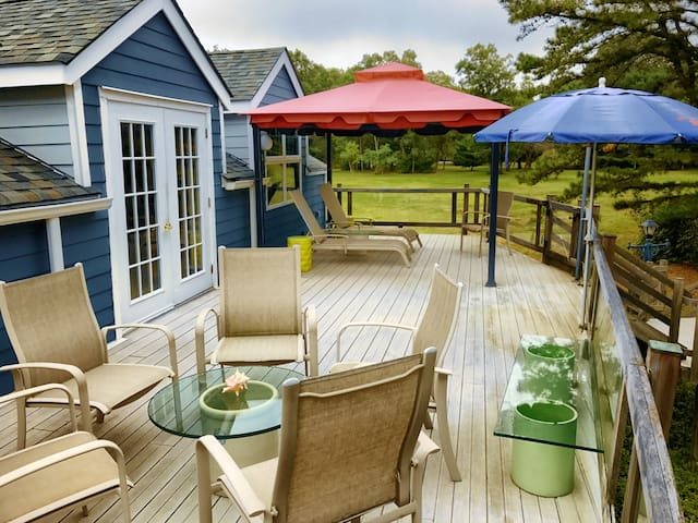 400+ square foot deck has BBQ 6 out door chairs and 2 lounge chairs with canopy and stairs down to the field