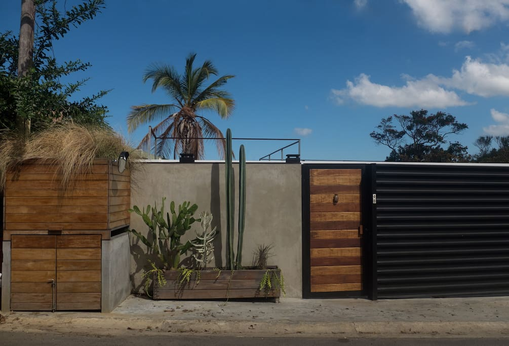 Extremely private and secure 10' wall of concrete and metal surround the entire property for maximum privacy.