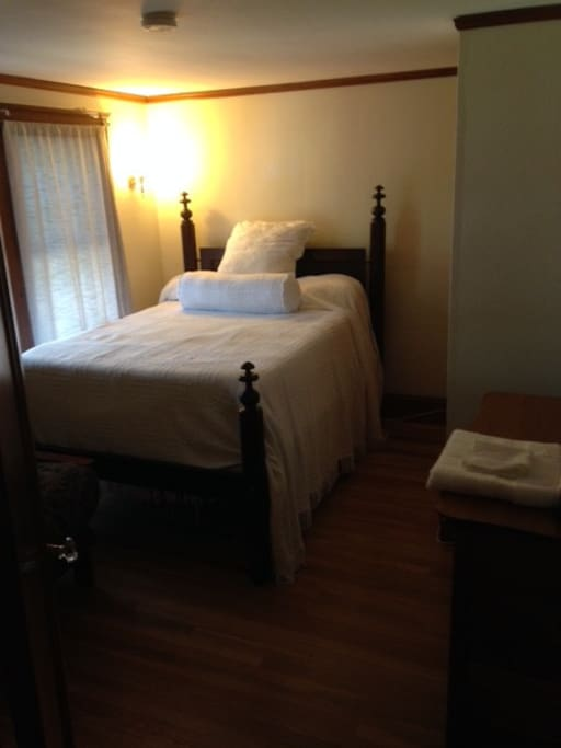 Bedroom sleeps two, includes private bath, separate sitting room, chest of drawers, closet.