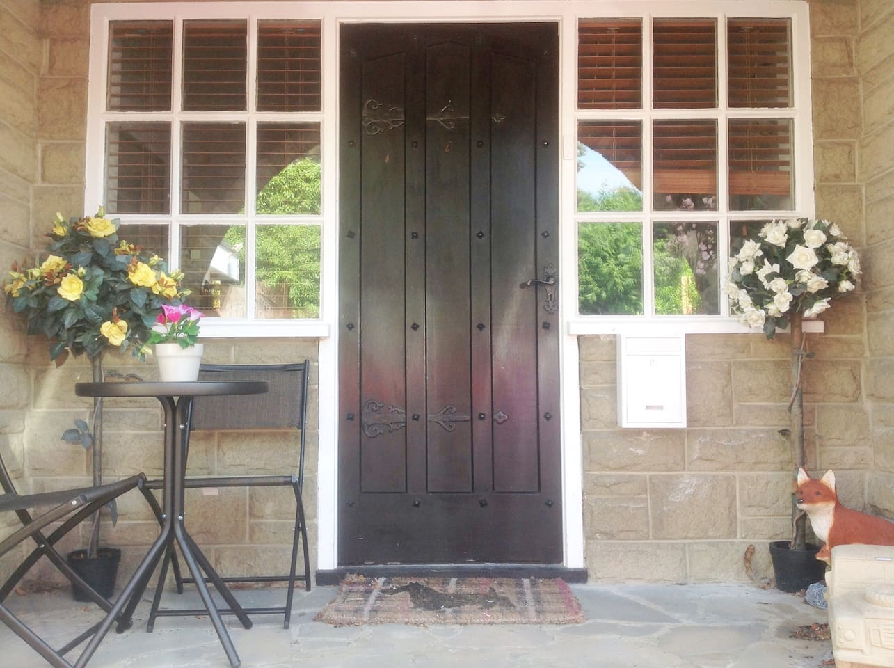 Private entrance porch and door with al fresco dining.  You can come and go as you please.  The porch is a real sun trap in the evening if you fancied a takeaway!