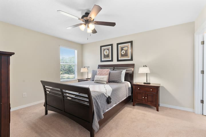 """This second floor bedroom features a Queen size bed with memory foam, a 43"""" smart TV & private attached bath."""