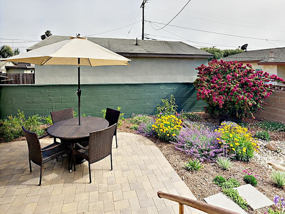 Backyard - Quiet, private backyard features outdoor furniture and a propane grill.