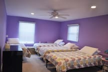 4 twin Tempur-Pedic beds are in the large purple bedroom.
