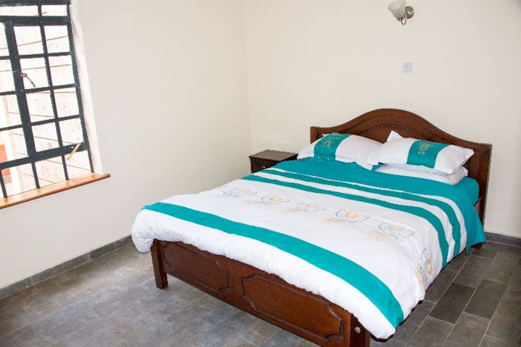 A spacious, clean bedroom with ample storage spaces.