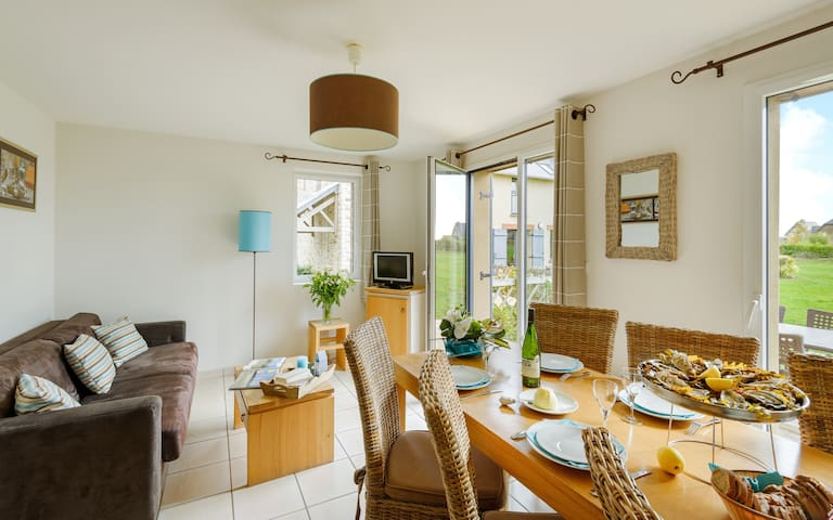 Loads of room at the dining table and the open concept is always nice for the cook.
