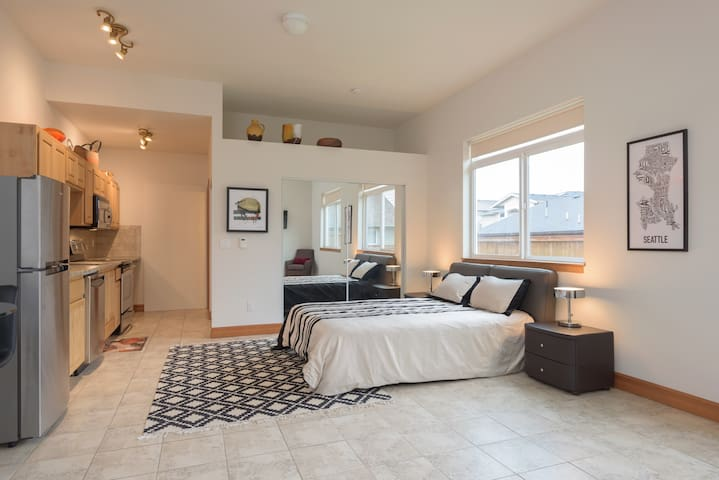 High ceiling and heated floors throughout studio.