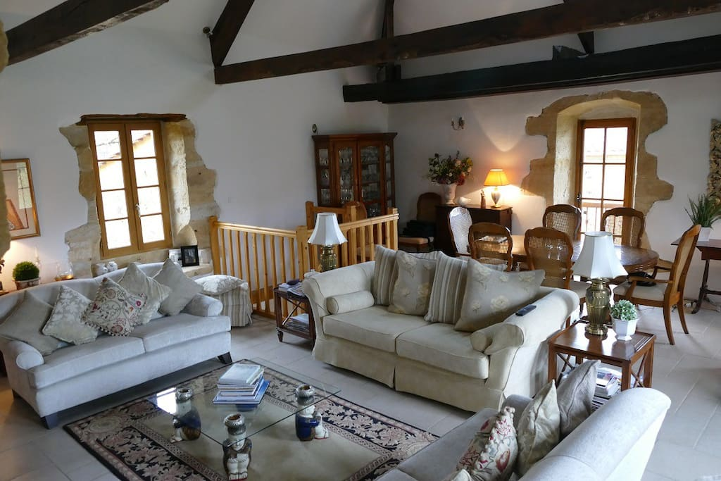 Lounge open to the rafters with soft tones and beautiful furnishings