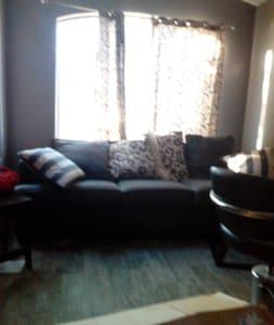Nice house. Comfortable couch. - Marana