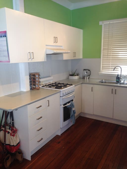 Full kitchen with gas stove and oven, dishwasher, stainless steel appliances, fully stocked with all equipment.