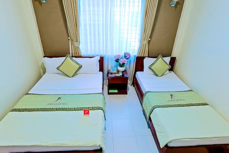 Separate beds - Great location @ centre of Hue - tp. Huế