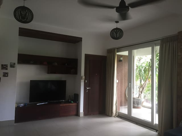 Living area to balcony (front door entrance)