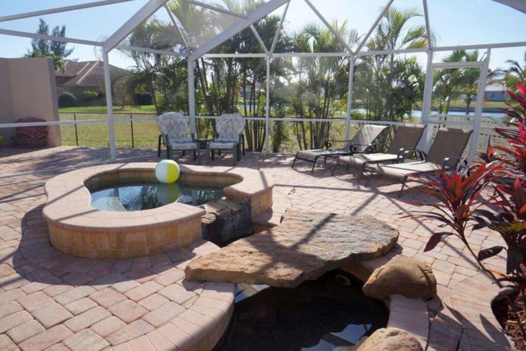 Electric heated spa and lounging area.