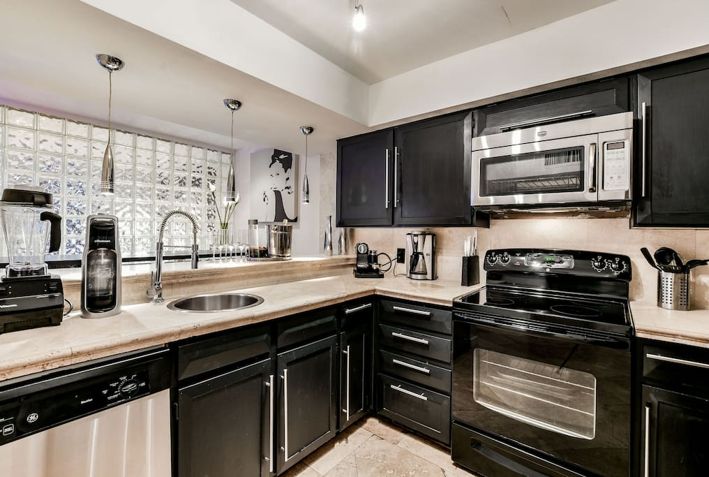 Spacious Modern Kitchen with a dine-in bar and stainless steel appliances