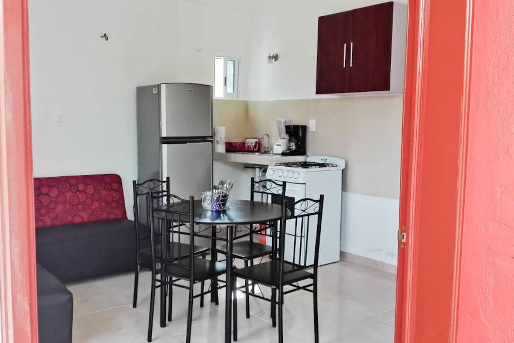 The kitchen and living space. It's equipped with all basic dishes you might need for cooking, coffee maker, mixer.