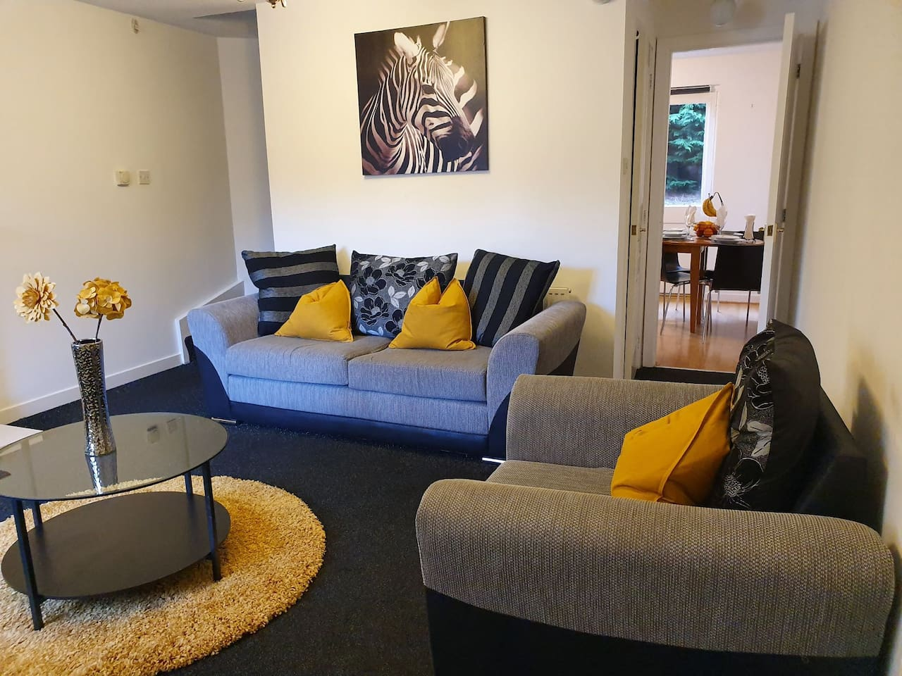 Comfortable living space with direct access to the kitchen and rear garden
